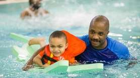 Julian Coston of Farmingdale enjoys family swim night
