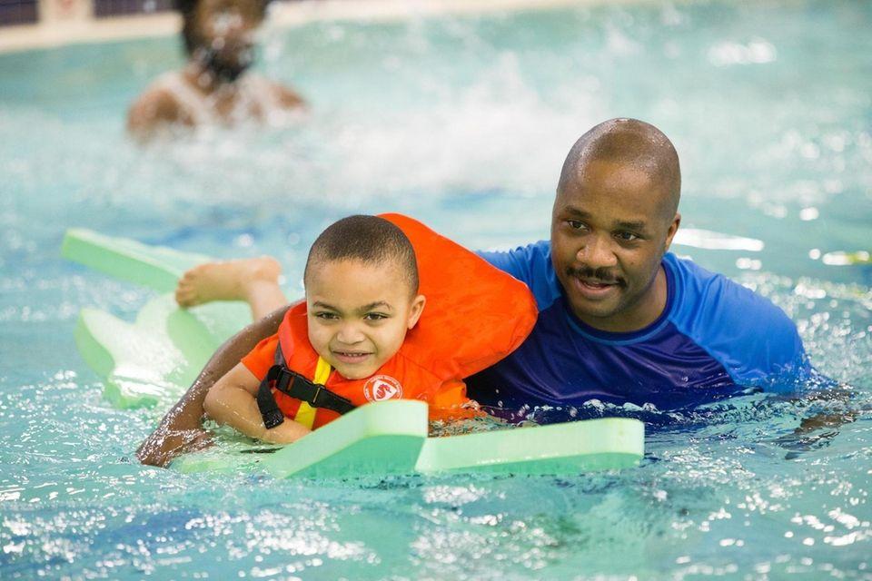 Julian Coston of Farmingdale enjoys family swim night