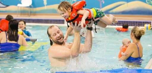Christian Brodersen of Bellmore hoists his son, Axel,