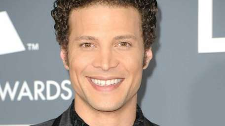 Singer Justin Guarini arrives at The 53rd Annual
