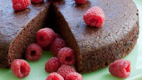Semi-Wacky Chocolate Cake is garnished with fresh raspberries.