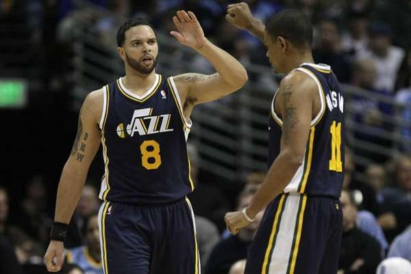 Utah Jazz point guard Deron Williams (8) gives