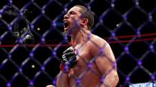 Robert Whittaker reacts after his middleweight title bout