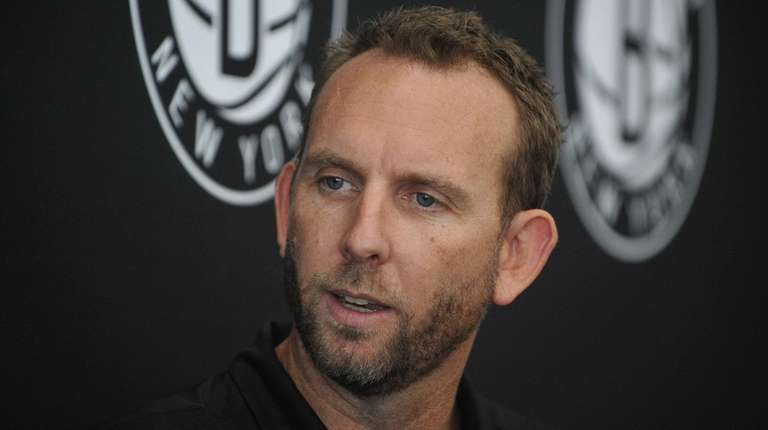 Nets general manager Sean Marks, shown here back
