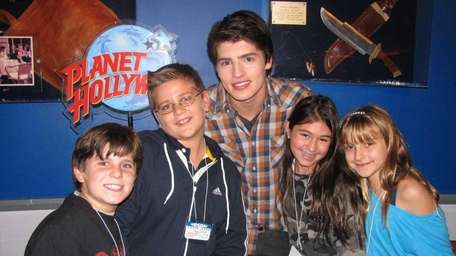 Actor Gregg Sulkin with Kidsday reporters, from left,