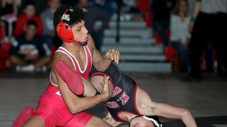Center Moriches' Jordan Titus wrestles Mt. Sinai's Brendan