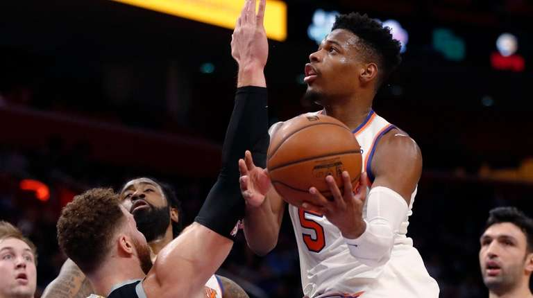 Knicks guard Dennis Smith Jr. is defended by