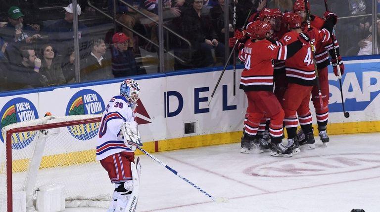 Rangers goaltender Henrik Lundqvist stands in front of