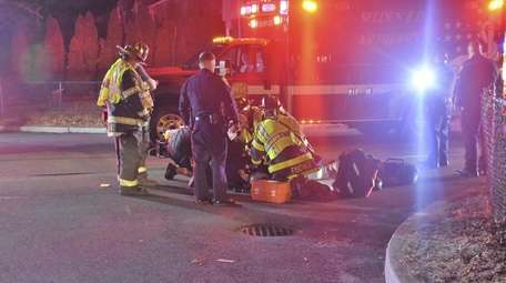Emergency responders tend to a man struck by