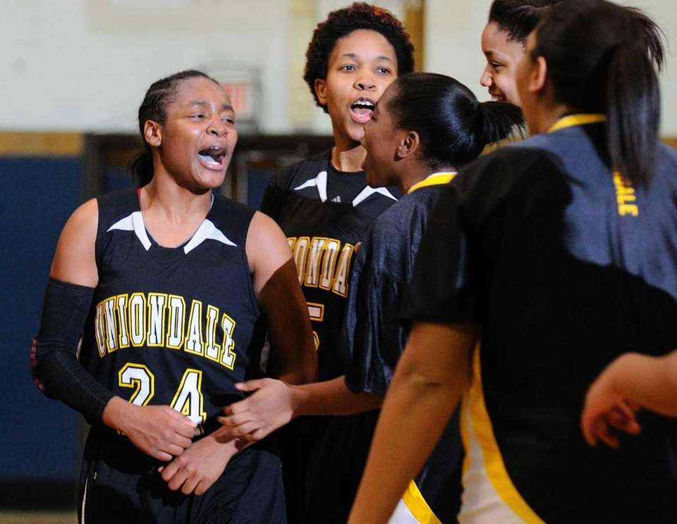 Aliyah McDonald, left, celebrates with teammates after their