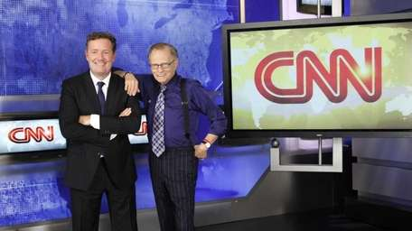 CNN's Larry King poses with newly announced CNN