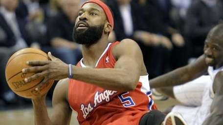 The Los Angeles Clippers' Baron Davis (5) looks