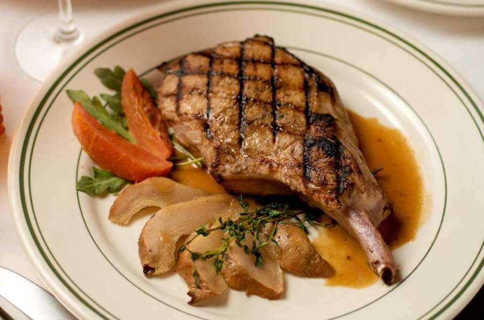 A Berkshire pork chop served at George Martin's