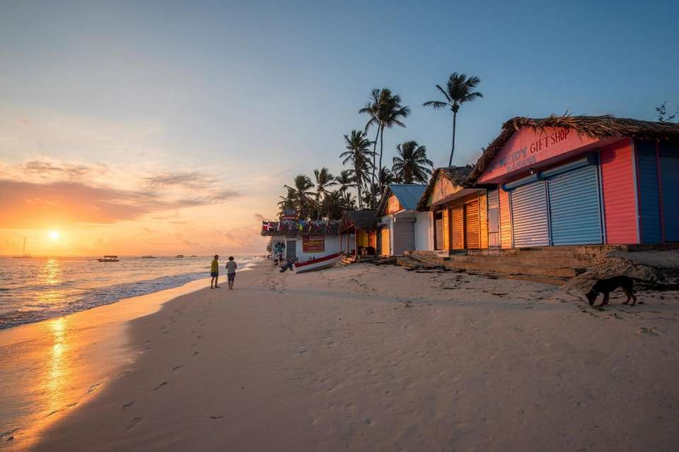 Beach huts at sunrise along Bavaro Beach in