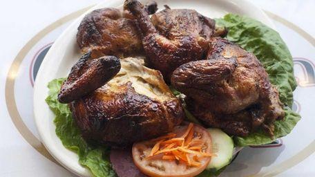 Pollo entero a la brasa, whole rotisserie chicken,