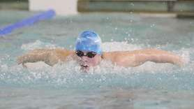 Comsewogue's Jake Vecchio wins the 100 yard butterfly