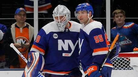 Robin Lehner and Johnny Boychuk of the Islanders
