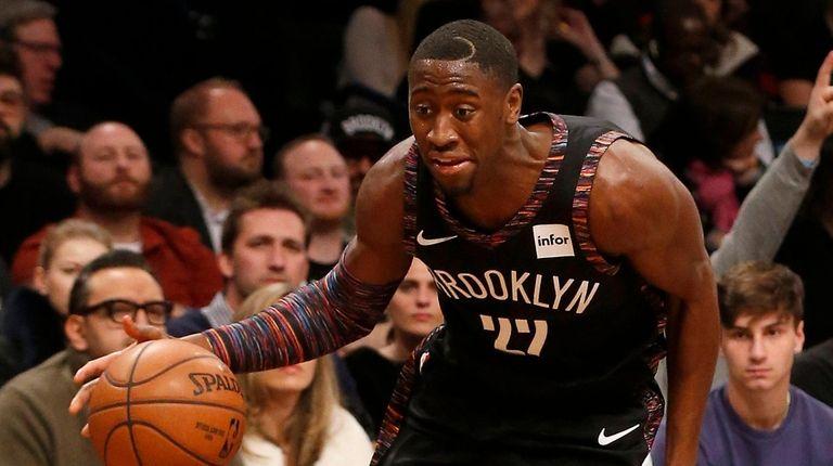 Caris LeVert #22 of the Brooklyn Nets drives