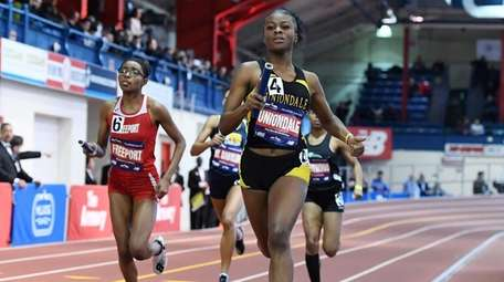 Zaria Fuller of Uniondale runs the anchor leg