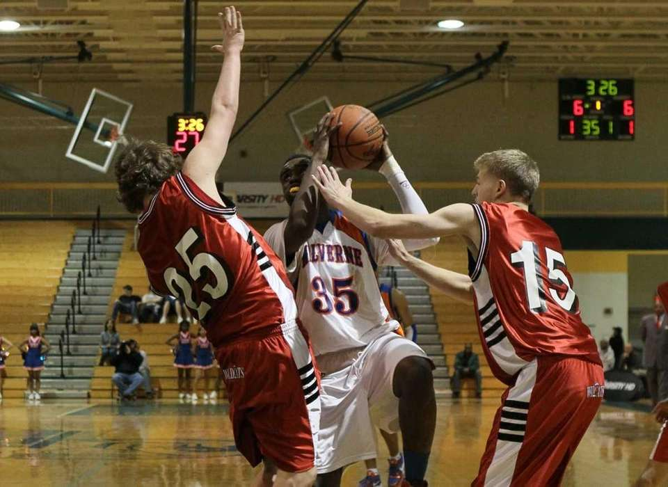 Anthony Moultrie #35 of Malverne drives against Bryan