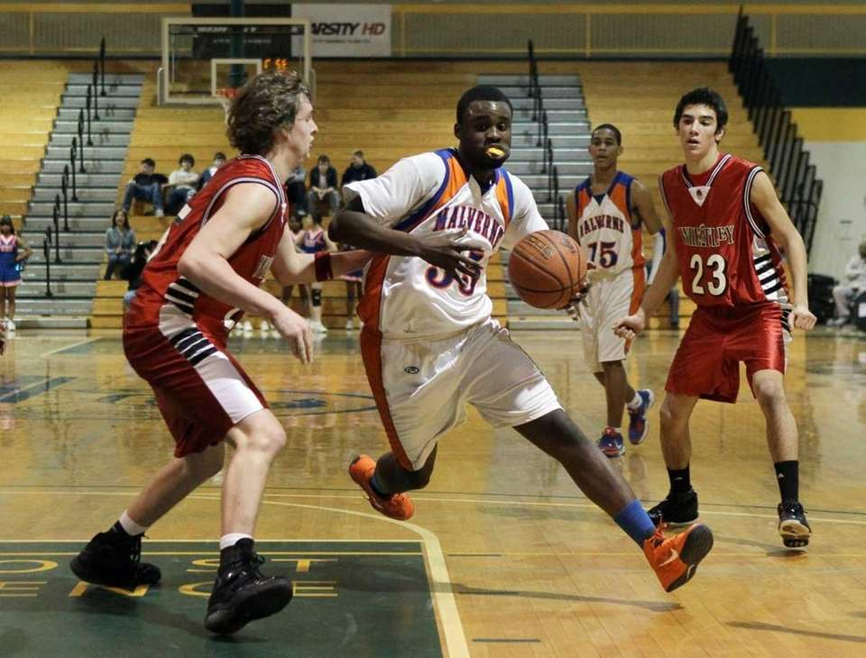 Andre Berry #55 of Malverne drives against Bryan