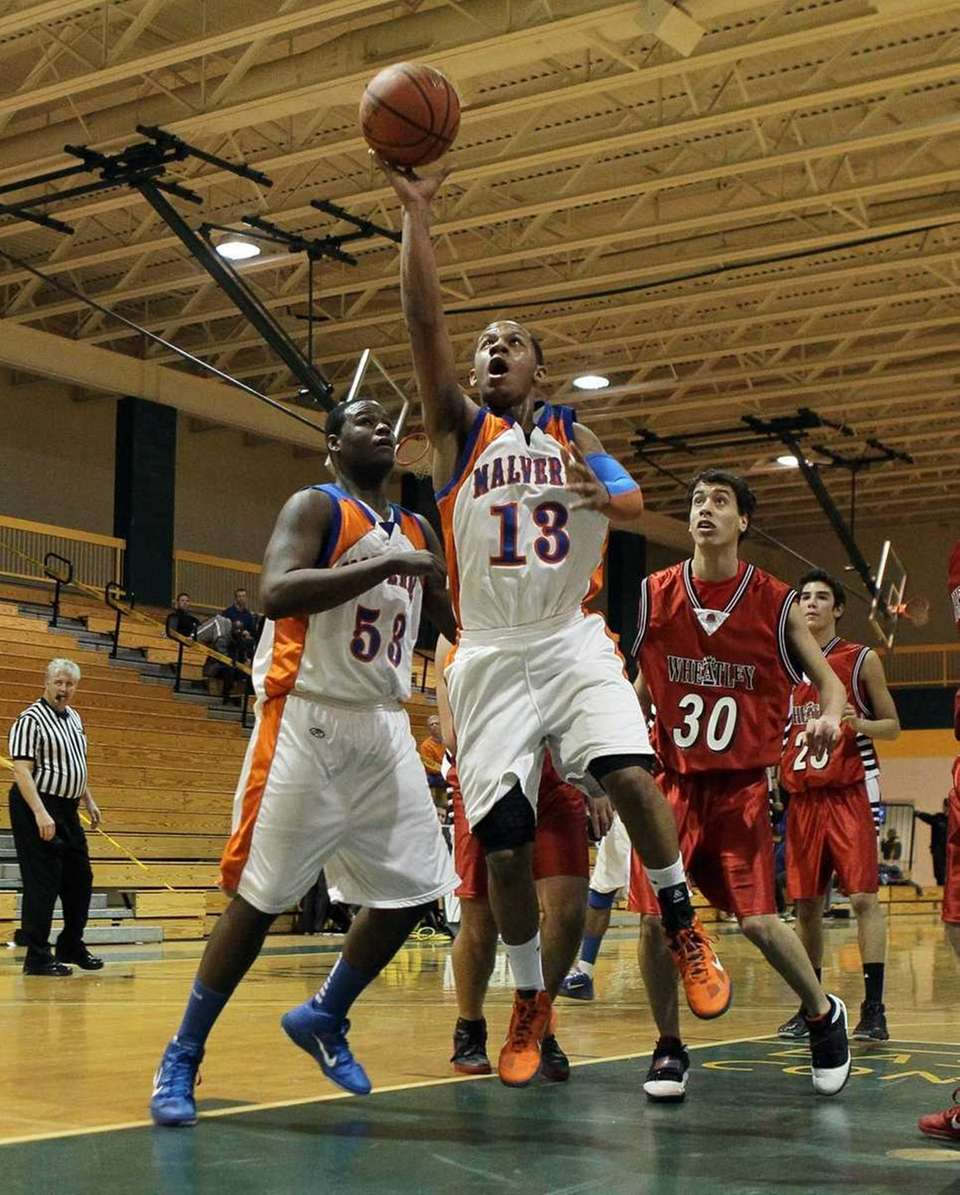 Cory Alexander #13 of Malverne lays up a