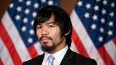 Filipino boxer and congressman Manny Pacquiao listens to