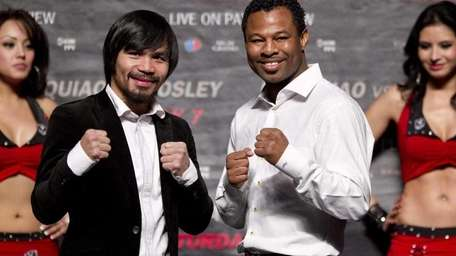 Manny Pacquiao, left, and Shane Mosley pose for