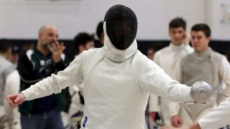 Ward Melville's Ben Rogak competes in the epee