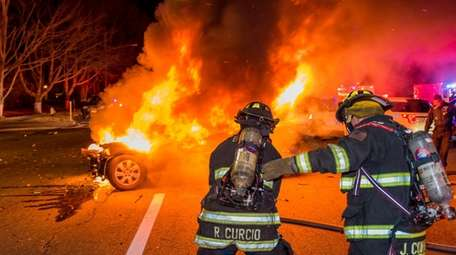Firefighters at the scene of the crash on