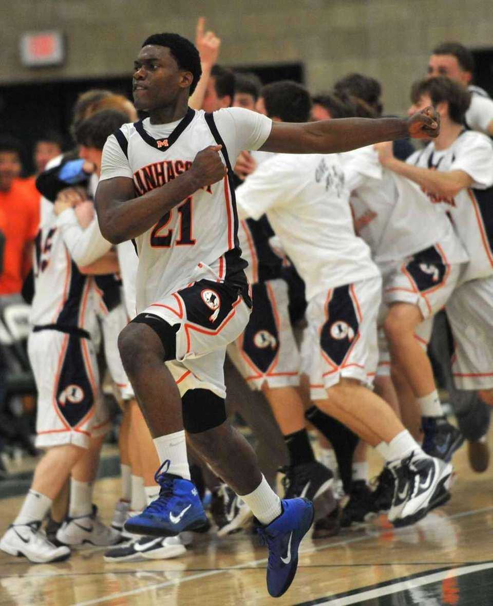 Manhasset's Gary Tibbs (21) leaps into the air