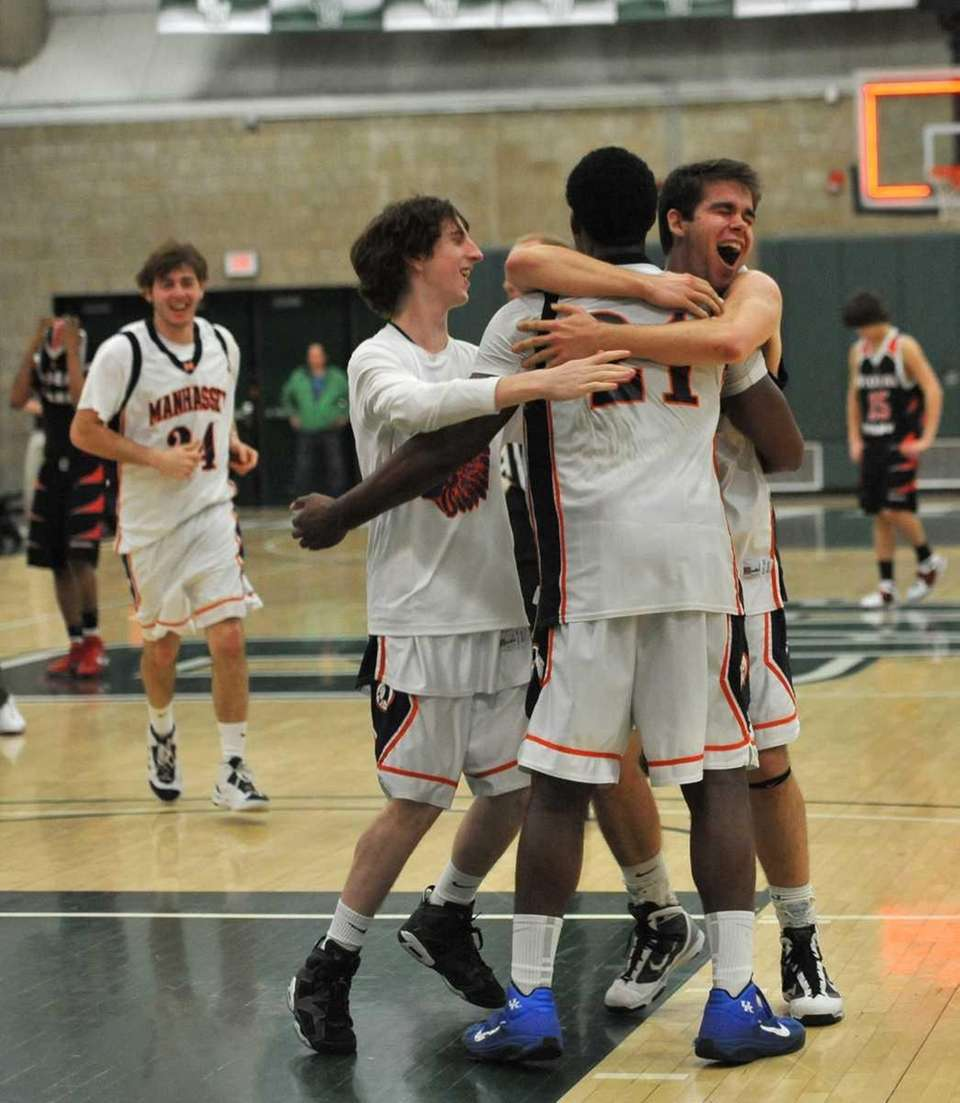 Manhasset's Mathew Tompkins (24) rushes in to celebrate