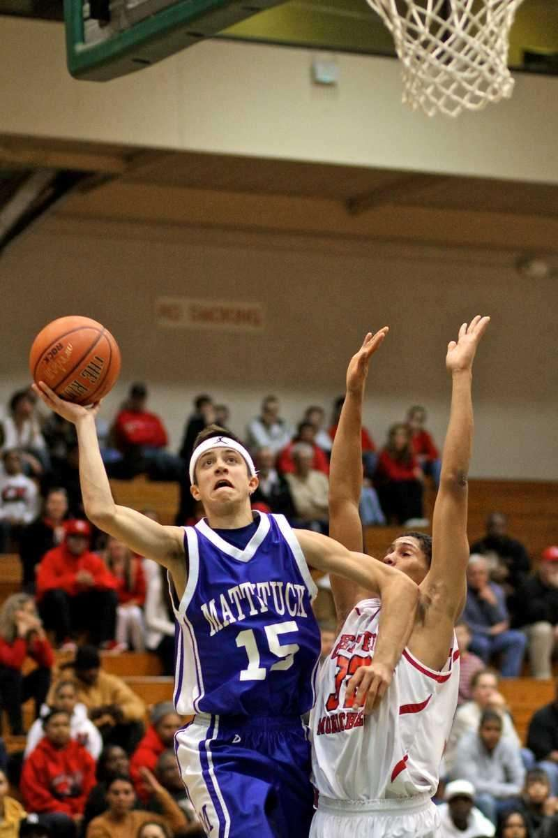 Mattituck guard Mike Mangiamele #15 drives the baseline