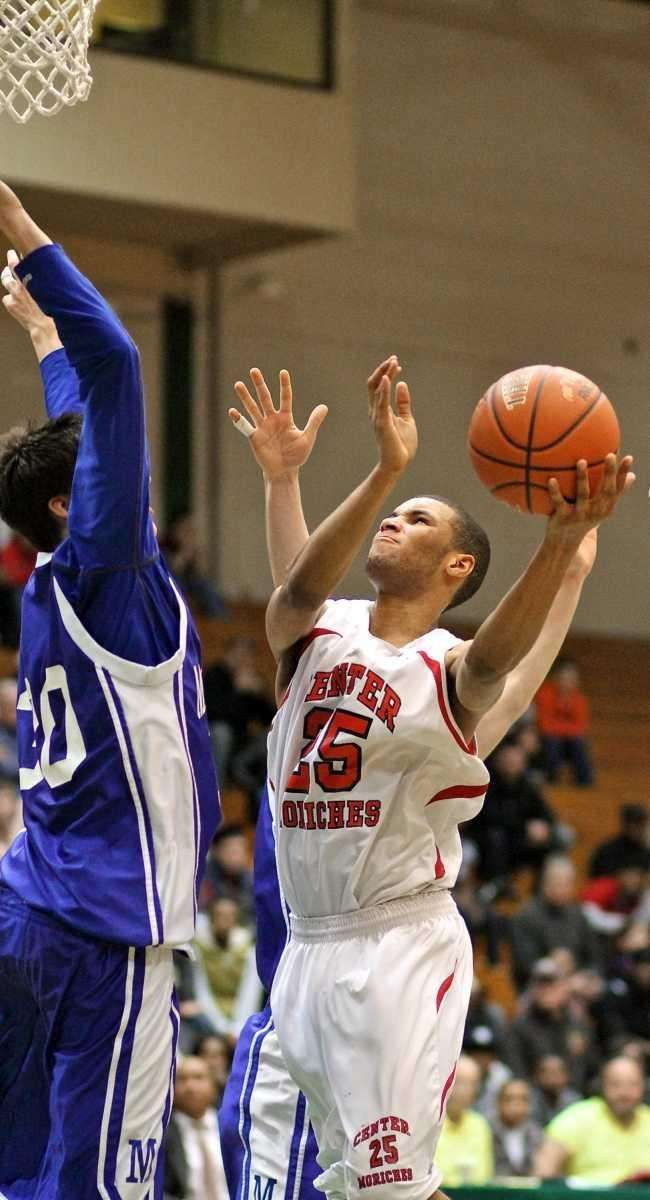 Center Moriches forward George Williams #25 drives the