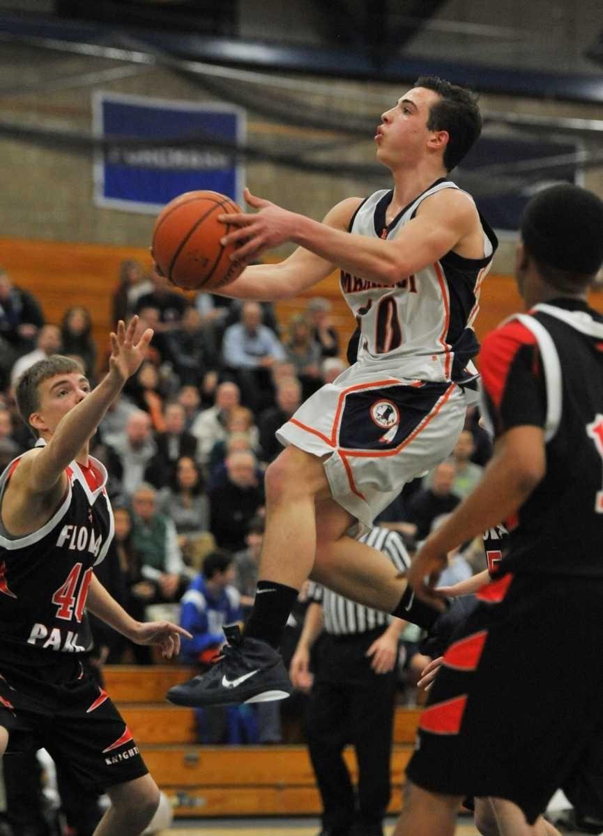 Manhasset's Anthony Amitrano (10) drives the ball to