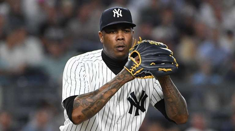 Yankees relief pitcher Aroldis Chapman looks at first