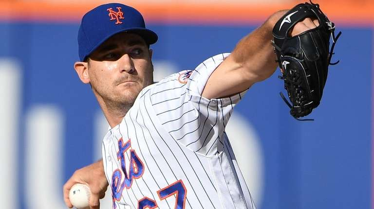 New York Mets relief pitcher Seth Lugo delivers