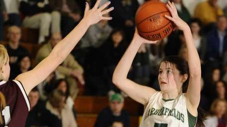 Harborfields' Alexia O'Connor shoots against Kings Park in
