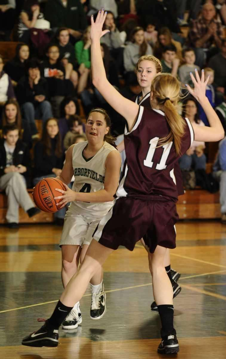Harborfields' Jana Amchin drives to the basket guarded
