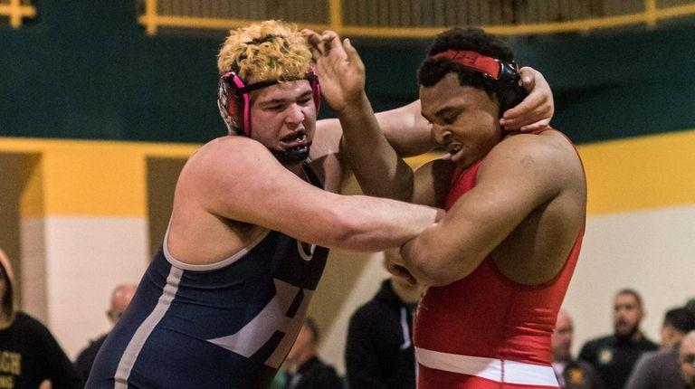 Freeport High School Boys Wrestler, Myles Norris (right),