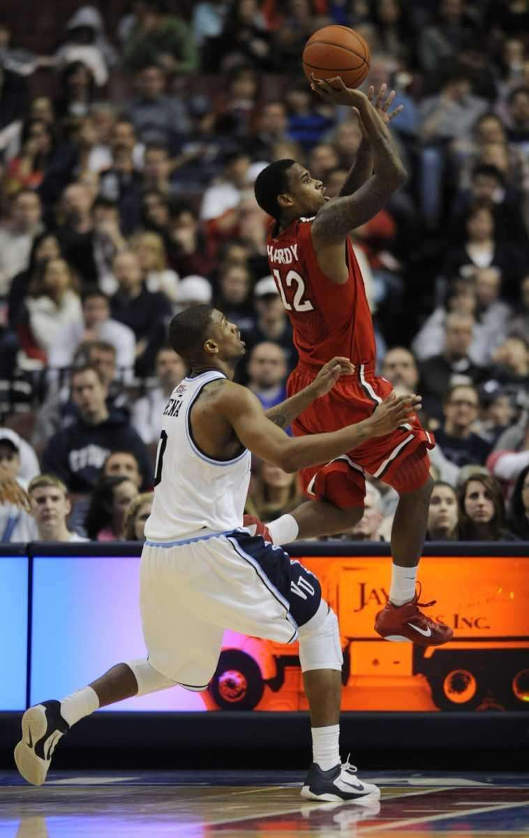 St. John's guard Dwight Hardy (12) shoots past