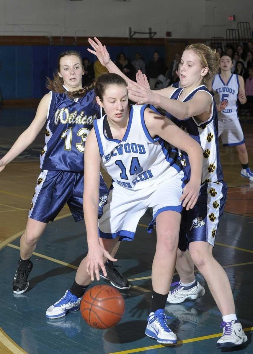 Glenn's Alison McKenna(14) drives past her defender Alyssa