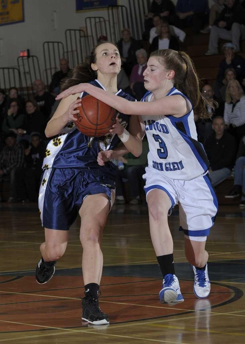 Glenn's Emma Klis (3)is called for the foul