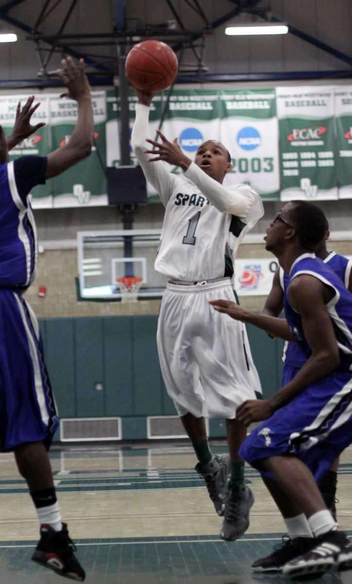 Elmont's Robert Chambers moves toward basket during the