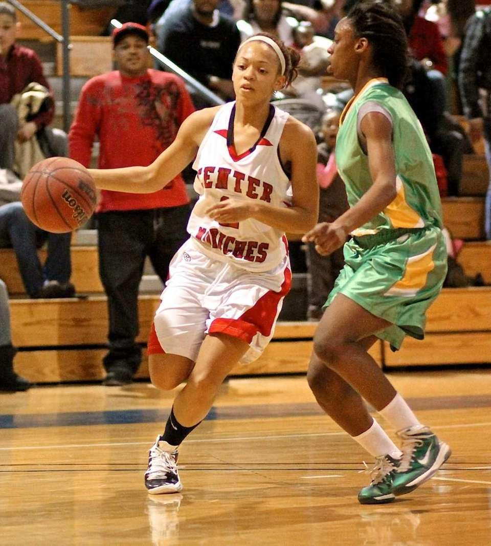Center Moriches guard Takia Plummer #11 drives the