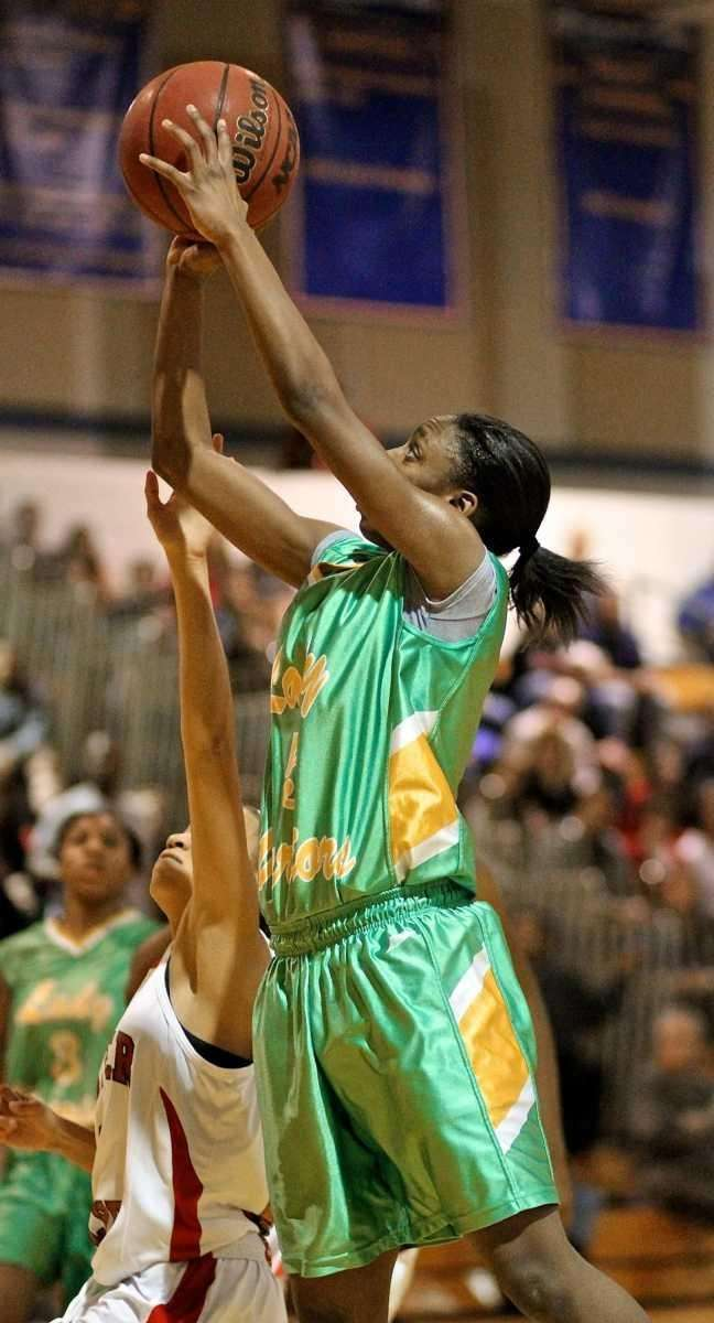 Wyandanch guard Jalicia Robinson #5 put in the