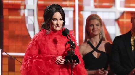 Kacey Musgraves accepts the award for best country