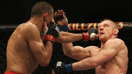 George Sotiropoulos of Australia punches Dennis Siver during