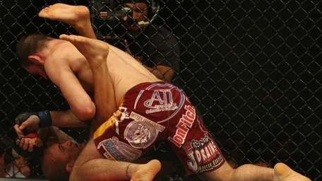 BJ Penn of the USA is pinned down