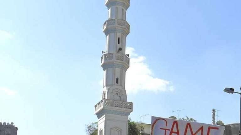 Egyptian anti-government protesters march in Assiut, Egypt. (Feb.